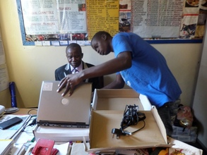Headmaster Receiving Laptops From The Foundation