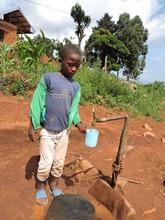 Young child enjoying fresh water