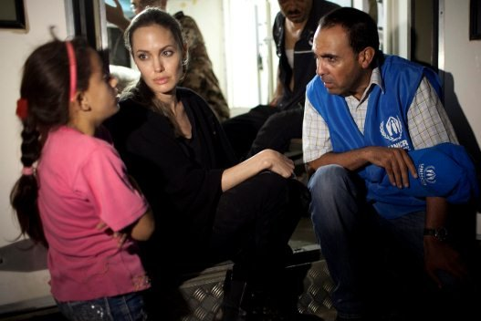 Angelina Jolie speaks with a young Syrian refugee