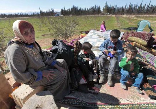 Syrian family arrives in Lebanon AP Photo/H.Malla