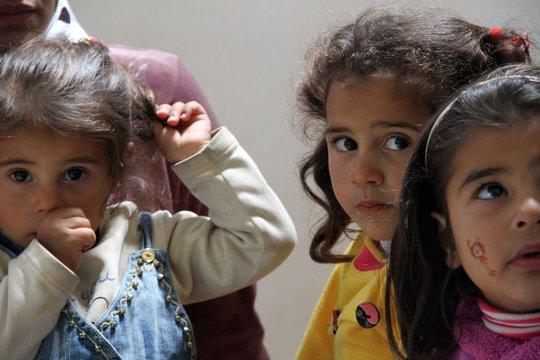 Three young Syrian refugee sisters; Halba, Lebanon
