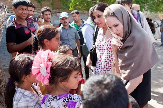 Angelina Jolie meets with Iraqi refugees.