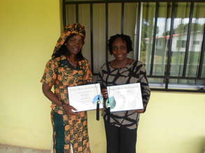 Grace & Vaiba displaying the Graduate Certificates