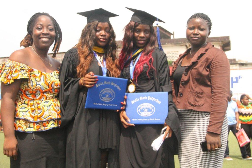 Graduates Patience (R) & Nowoe (L) w/Program Staff