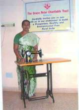 Mrs. G.Kanchana with donated Sewing Machine