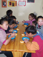 Children eating at Lamp of the Path