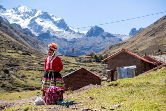 Artisan from Kelkanca in front of her home