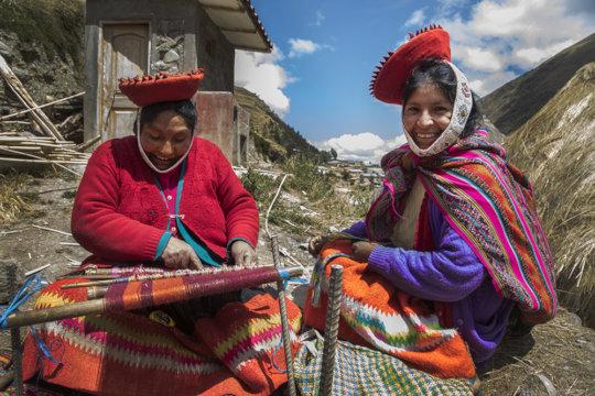 Cristina and Yolanda work together on a textile.