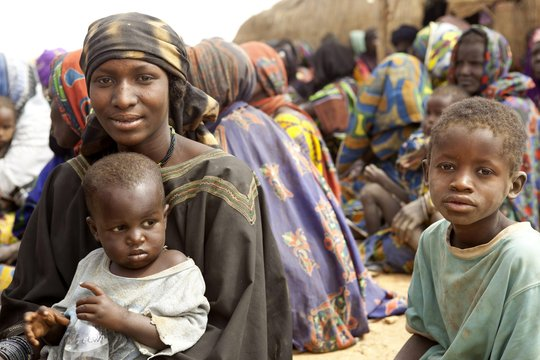 A Malian family waits for relief items from UNHCR.