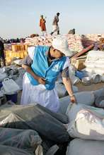 A UNHCR employee manages supply distribution.