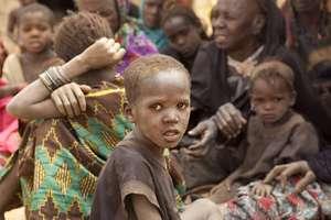 A Malian refugee boy waits at an aid distribution