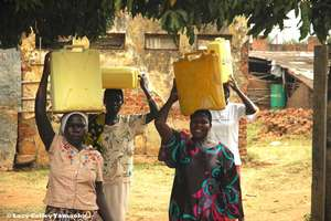 GWWI in Moyo- How to carry 5 gallons of water