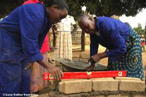 GWWI in Moyo - leveling each brick and each layer