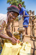 Filling up at a new well in Pallisa, Uganda