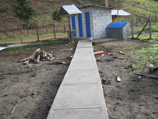 Sidewalk keeps bathrooms & wash station accesible
