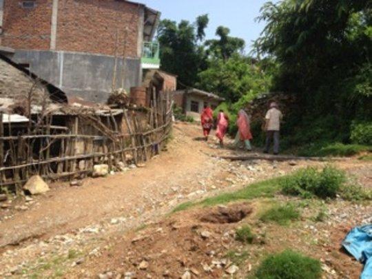 Yoga Tour participants strolling thru village.