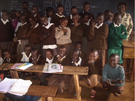 Irene (left of child in green) with her classmates
