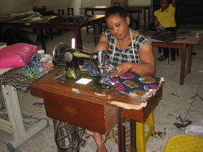 Obioma on her machine sewing her wear
