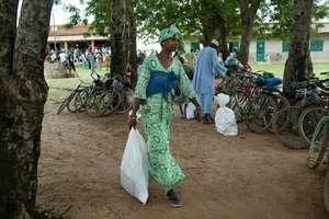 Aissatou Diallo takes home a hygiene kit