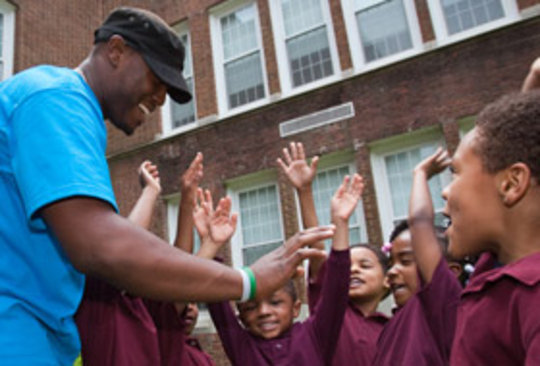 Playworks Coach gives High-Fives!