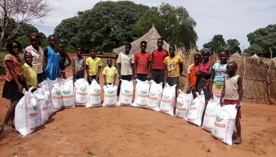 Distribution of ground maize to orphans