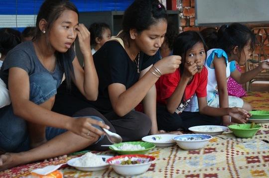Higher grade school children eating at Riverkids