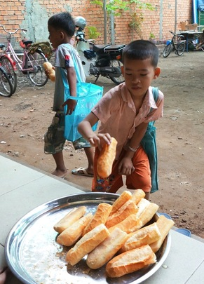 Children collecting their baguette before class
