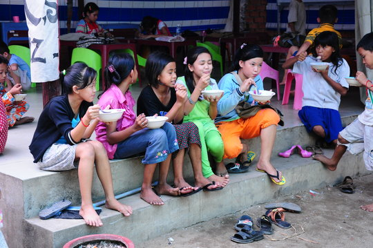 Children gather for a hearty meal