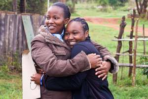 Teacher Victoria gets a hug from student Maureen