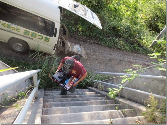 Climbing the steep ladder with a heavy equipment
