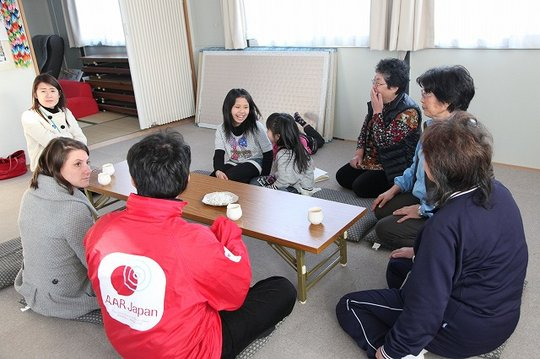 Talking with evacuees in temporary housing complex