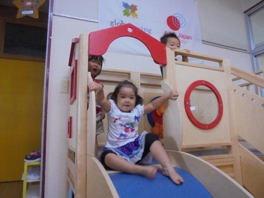 Children play on the slide