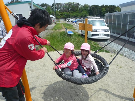 Children enjoyed the 'Cradle Swing' with AAR staff