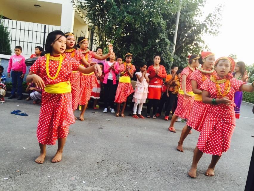 Children performing cultural dance...