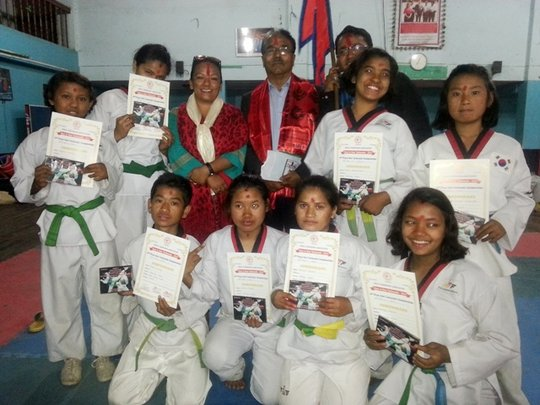 Showing certificates after won Taekwondo compet...