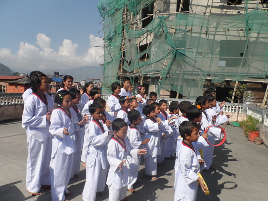 Children performing in Taekwondo dress!