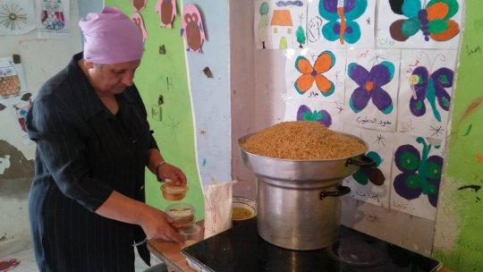 Hajjar preparing the dish in Karama