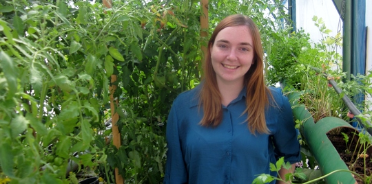 Amber, Karama volunteer visiting one of the garden