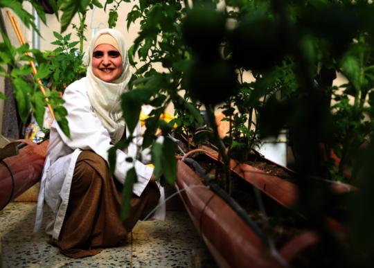 Proud Ne'ama in her greenhouse!