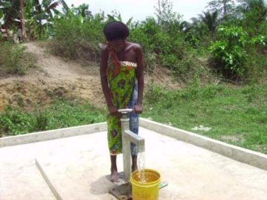 A woman drawing water from a well in Ghana.