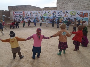 Farida and her classmates playing outdoors
