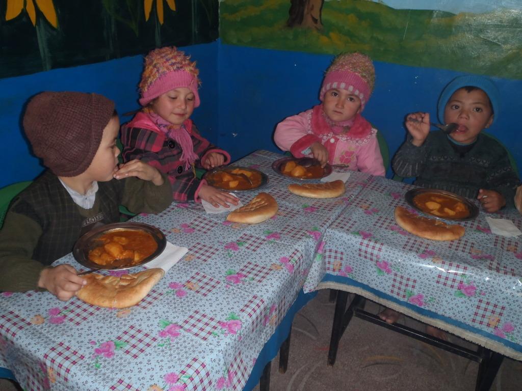 Children at the Center enjoy a potluck lunch.