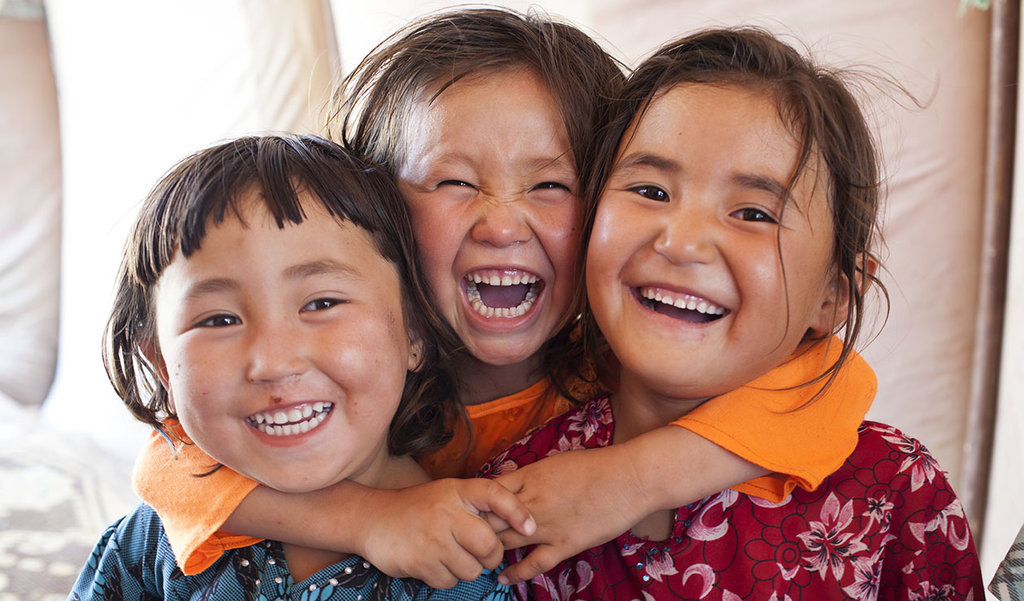 Three friends show their enthusiasm for learning.