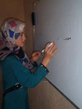 Mahem, 13, practices during morning prep class.