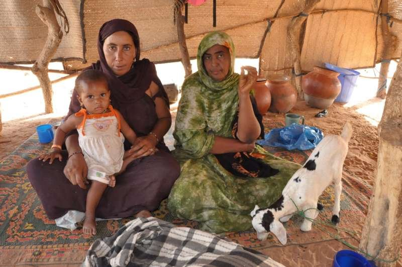 Courtesy of UNHCR, Aicha (green) in a refugee camp