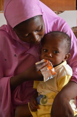 Courtesy of Edesia, mother feeding baby Plumpy