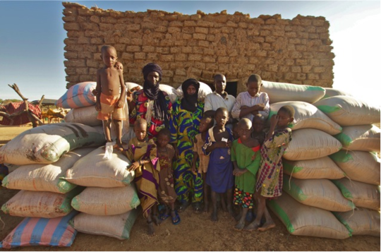 Seiga children and parents with grain delivery