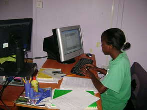 Mentee being trained on computer skills