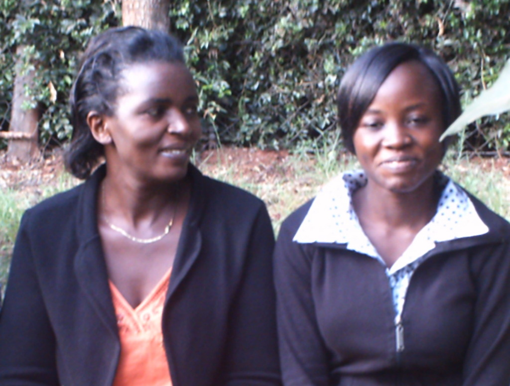 Catherine talking with girl beneficiary