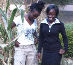 Girl beneficiary sharing with another girl
